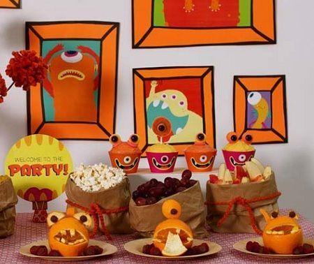 decoracion mesa cumpleanos monstruos naranjas